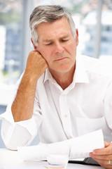 Unhappy senior businessman