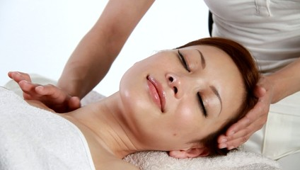 woman having neck massage