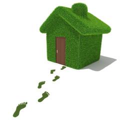 Green grass house with grass footprints