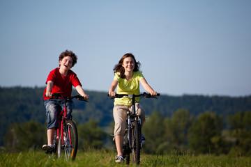 Girl and boy riding bikes