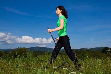 Nordic walking - active woman outdoor
