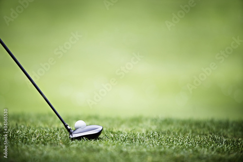Golf background with driver and ball.