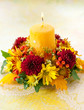wreath of autumn flowers and candle