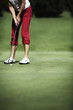 Female golfer putting