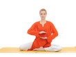 series or yoga photos. young meditating woman on yellow pilates