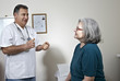 Male doctor talking with his patient