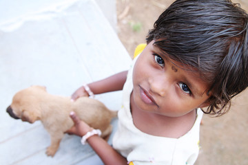Indian Little Village Girl Holding Little Dog