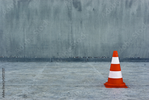 Single parking cone on concrete surface - 34372517