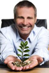 Business person happy about growth of financial wealth.