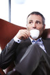 Closeup of businessman enjoying coffee.