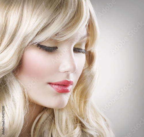 Blond Hair. Beautiful Woman Portrait. Hairstyle