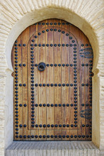 Typical studded wooden front door with knocker in Fes