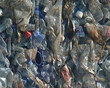 Huge piles of pressed pet plastic bottles prepared for recycling