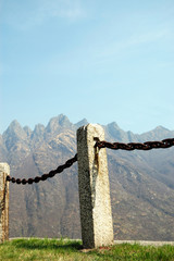 fence made of iron and stones, vertical
