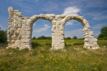 Ancient Roman arches under the sun in Burnum site