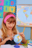 schoolgirl on geography lesson poster