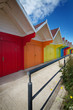 Row of beach huts on bright summer day