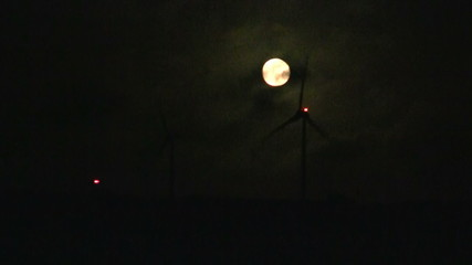 Windturbine and full moon in the Netherlands