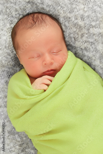 Newborn baby in green