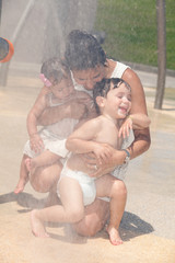 Young mother with her children outdoors in a park
