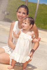 Pretty young hispanic mother with baby daughter