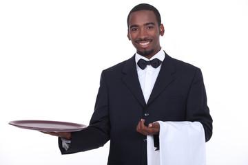 well dressed black waiter