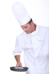 Chef holding saucepan