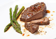 Grilled steak with Green asparagus on white background