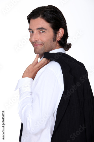 Roguish gent holding his jacket over his shoulder