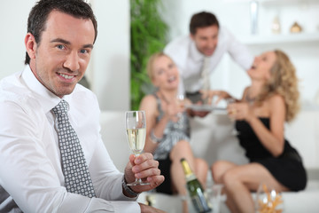 Man drinking champagne