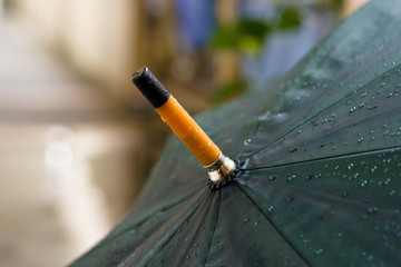 Umbrella with water droplets