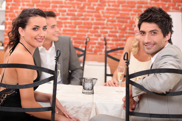 Two couples dining out in a restaurant