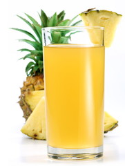 Pineapple juice in a glass of pineapple slices