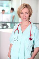Serious woman in hospital scrubs