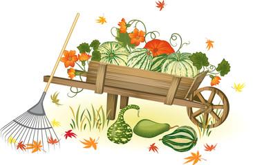 Handcart with heap of pumpkins