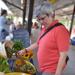 Woman at greens stand