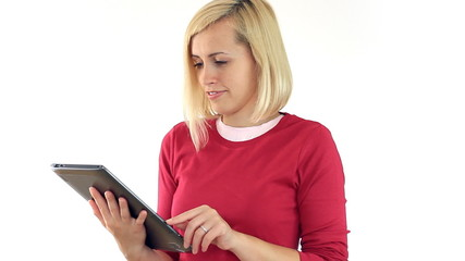 Happy attractive woman with tablet computer, isolated