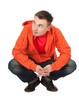 squats young man in orange sweatshirt, full length, series