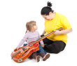 fat mother and daughter with electric guitar