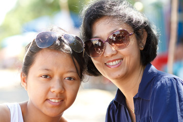 happy asian mother and daughter portrait