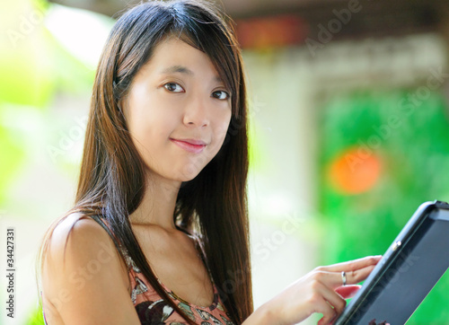 Beautiful young woman using tablet touch computer