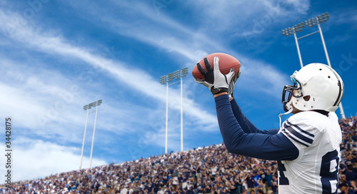 American Football Player catching a touchdown pass