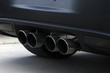 four pipes exhaust system on a sport racing car