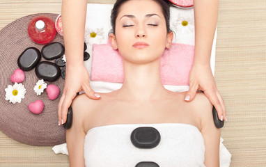 treatment  with hot stone