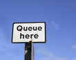 Queue here