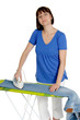 Woman ironing trousers