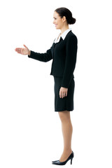 Full body portrait of smiling businesswoman giving hand
