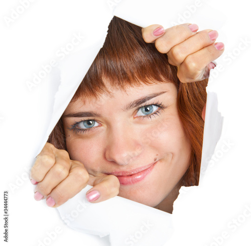 Girl is looking through a hole