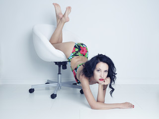 Beautiful brunette on white chair