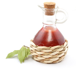 vinegar bottle and laurel leaf